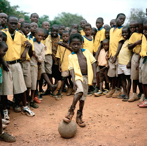 group picture of school kids with a football